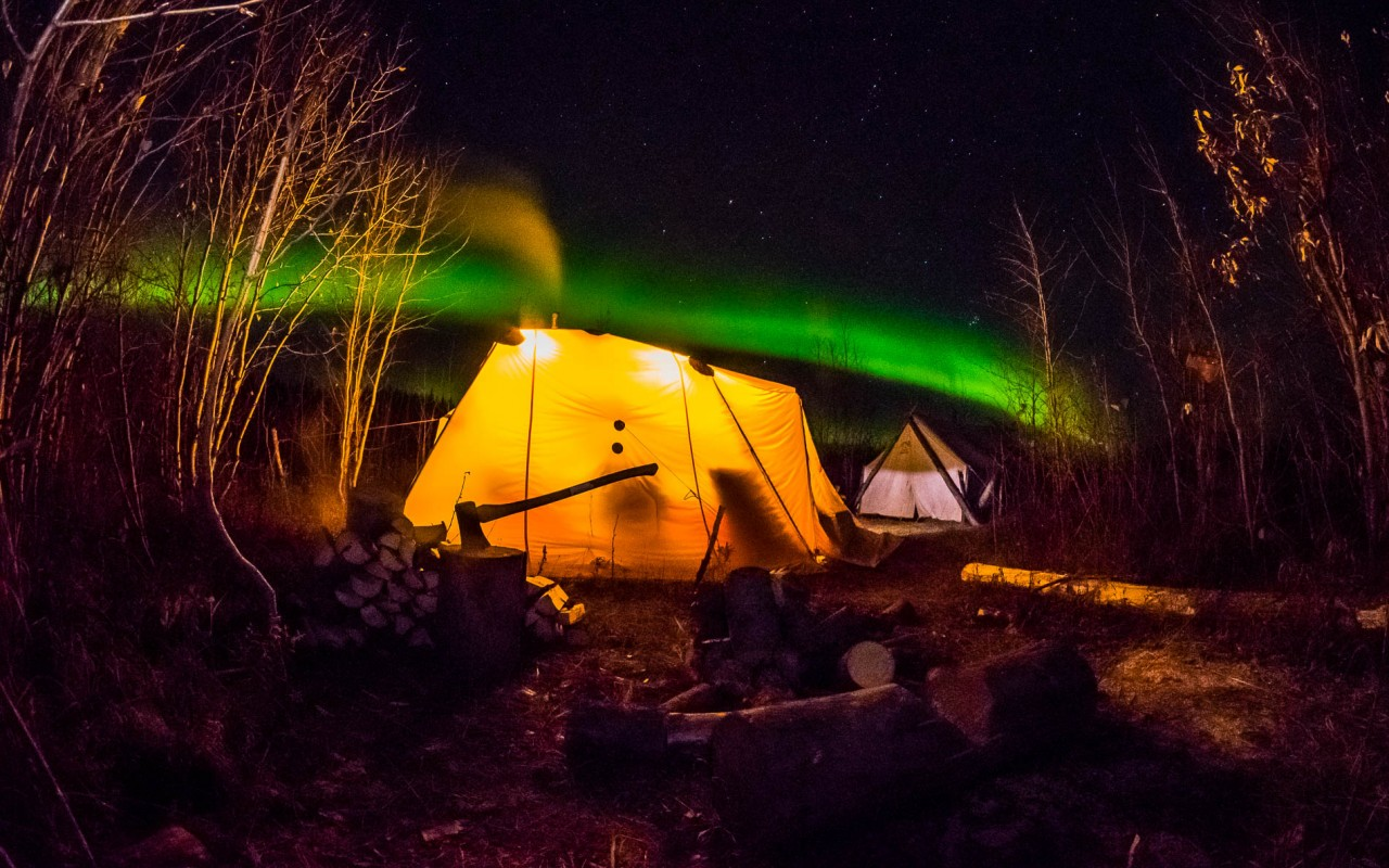 Aurora over the Arctic Oven tent in sheefish camp outide remote